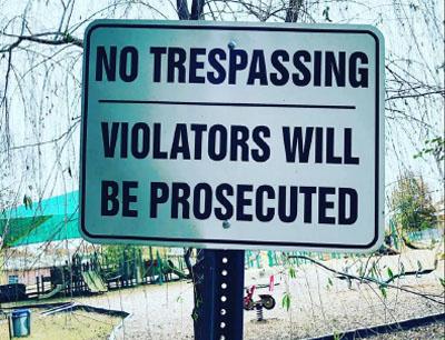 'no trespassing' street sign